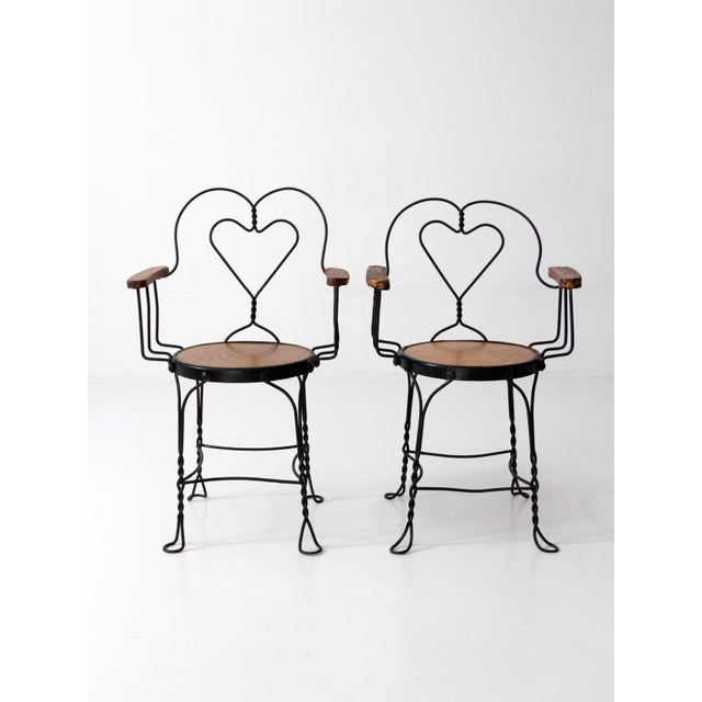 This is a pair of antique ice cream parlor chairs. The black metal bistro  chairs - Antique Ice Cream Parlor Chairs - A Pair Chairish