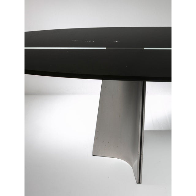 Remarkable Ufo table by Luigi Saccardo for Arrmet. Large glass surfboard shaped top with black serigraphy and aluminum feet.
