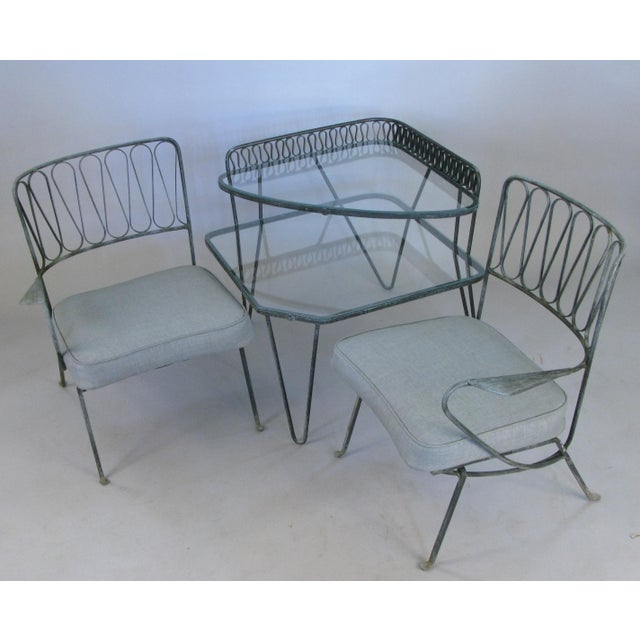 A pair of single arm lounge chairs in wrought iron designed by Maurizio Tempestini for Salterini, made in Italy in the...