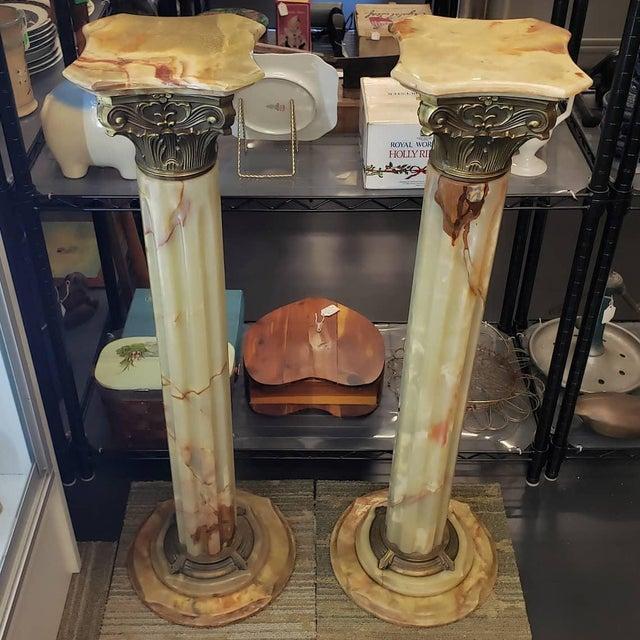 Up for sale is a beautiful Pair of Circa 1930 Italian Neoclassical Style Onyx/Gilt Metal Mounted Corinthian Column...