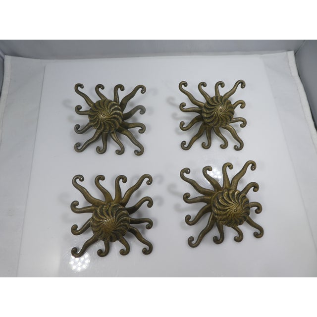 4 Amazing Antique Octopus / Squid Drawer Handles sold as found in vintage condition without damage.