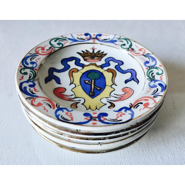 This charming set of 5 vintage Italian trinket dishes or individual ashtrays feature the painted crests from noble...