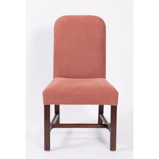 Upholstered pair of side chairs purchased from Axel Vervoordt covered in dusty mauve linen with dark stained legs. They...
