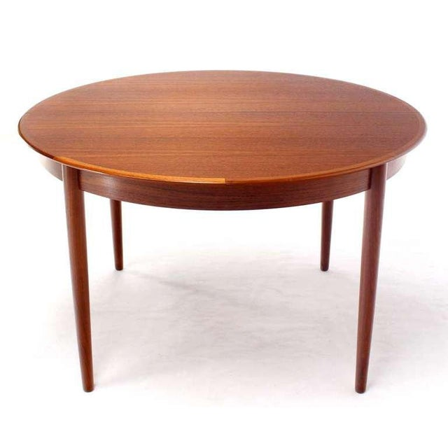 Early 20th Century Danish Mid-Century Modern Round Teak Dining Table with Three Leaves For Sale - Image 5 of 9