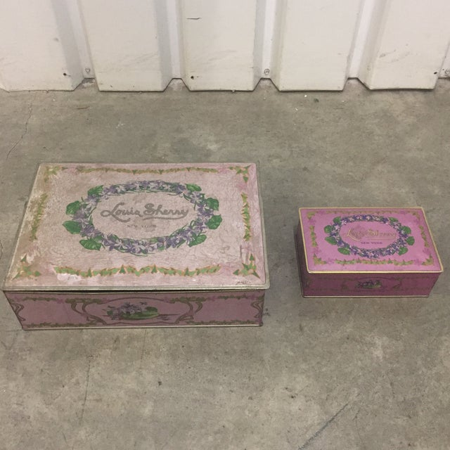 Two Louis sherry 1930s tins. Large- 8 x 11 x 3.5 Smaller- 6 1/4 x 4 x 2
