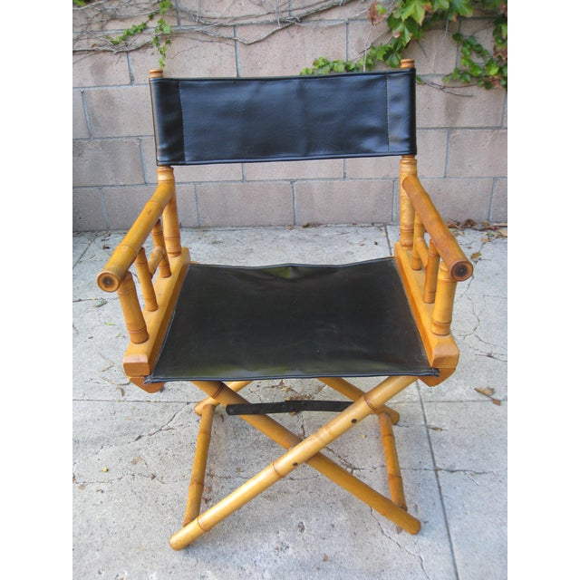 """Vintage 1960s bamboo & leather director's chair with a bamboo frame in the shape of an """"X"""" and straight arms. The seat and..."""