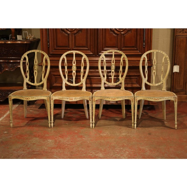 Use this colorful set of carved, antique chairs around a game table or breakfast table. Crafted in England, circa 1850,...