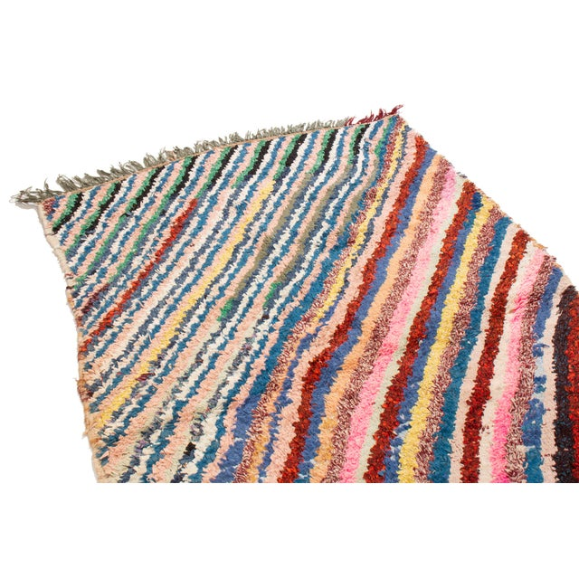 This vintage mid-century Moroccan rug resembles modern patterns hailing from the Azilal mountain region, often employed...