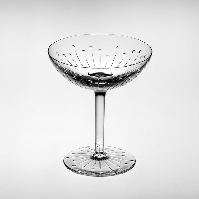 A mixed set of six contemporary and traditional cut crystal champagne coupes. A range of styles is included in the set...