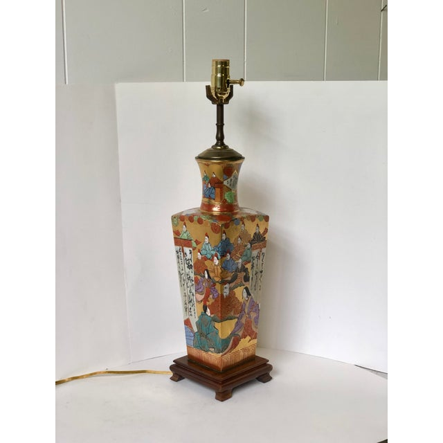 This beautifully detailed square tapering Kutani vase is mounted onto a carved wooden platform and wired as a lamp. The...