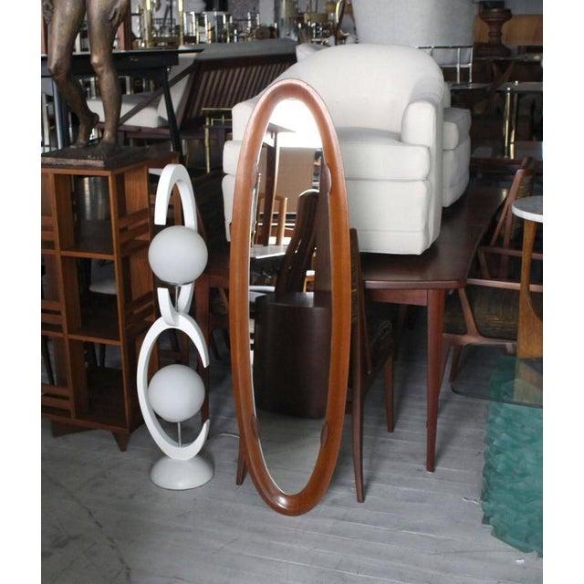 "Very nice Danish Mid-Century Modern oval mirror. Measure: 55"" H."