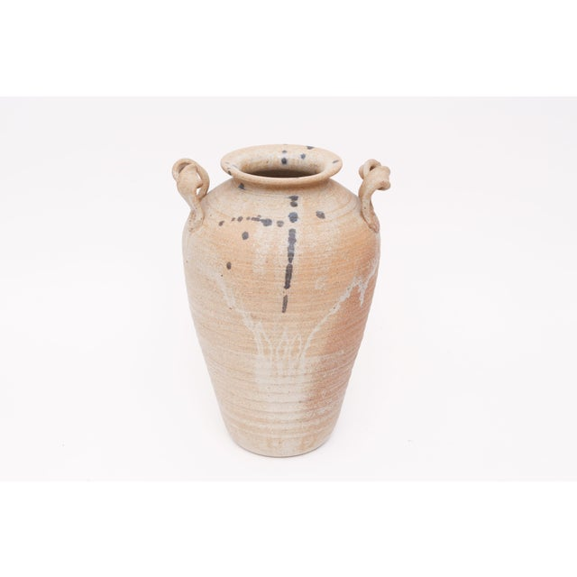 A beautiful brown and beige vintage pottery studio pottery vase. Good vintage condition, except one handle has hair line...