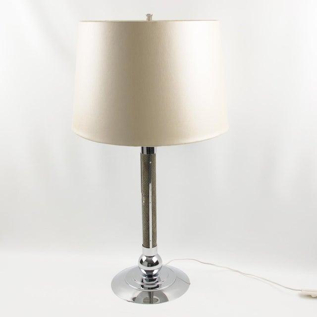 Elegant French Art Deco table lamp. Modernist design in chromed metal and shagreen (stingray skin) in natural beige-gray...