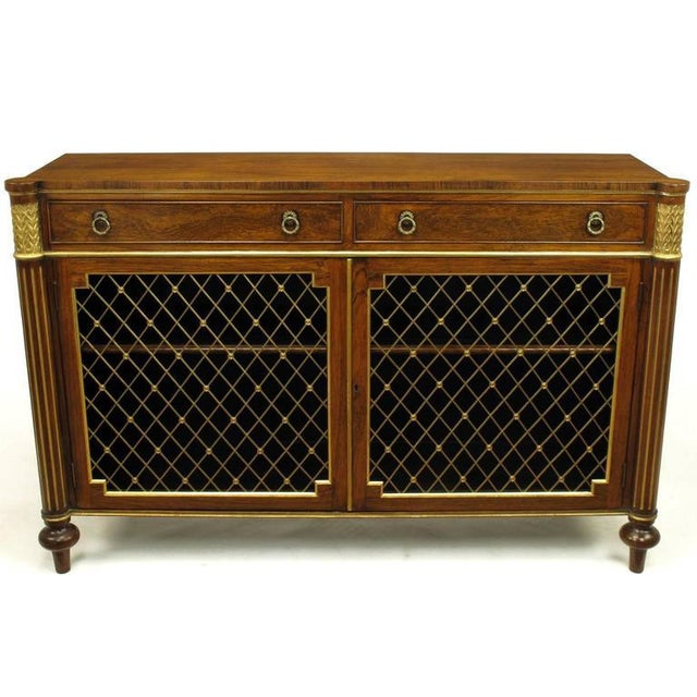 Rosewood commode or sideboard with diamond shape brass grill doors and fluted pilasters with gilt detailing by Arthur...