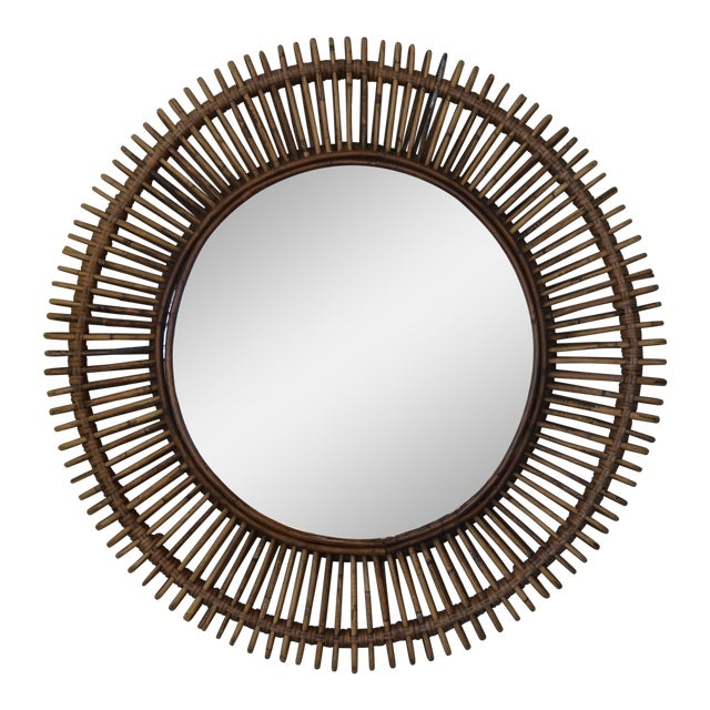 Pair of 'Oculus' round rattan mirrors by design Frères. Flat mirror inserted into an intricate rattan frame.