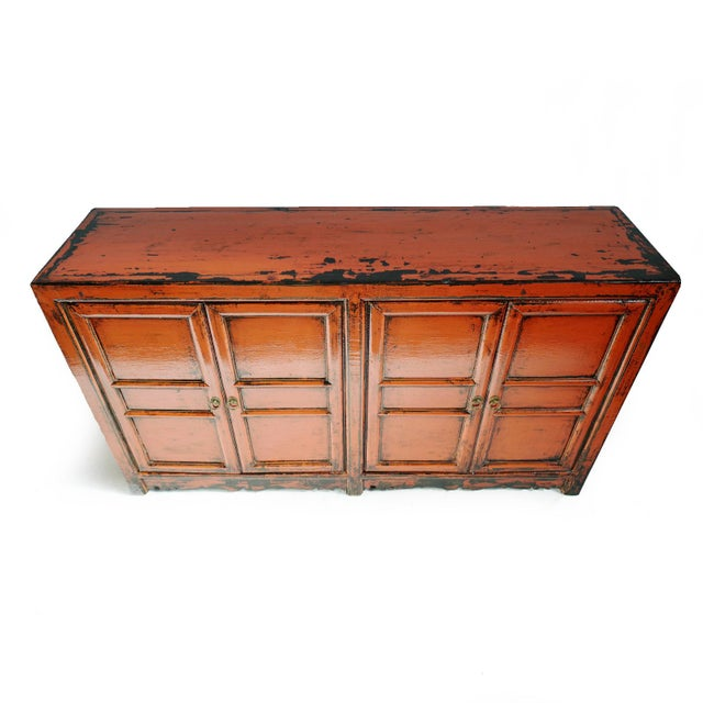 Antiqued Ming beautiful orange lacquered patina. Simple clean design with two storage cabinets and removable shelf plus...