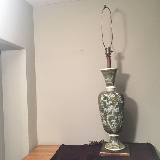 Amazing oversized vintage 1960's Chilo lamp. Retro olive green Porcelain with apple blossom design. This large statement...