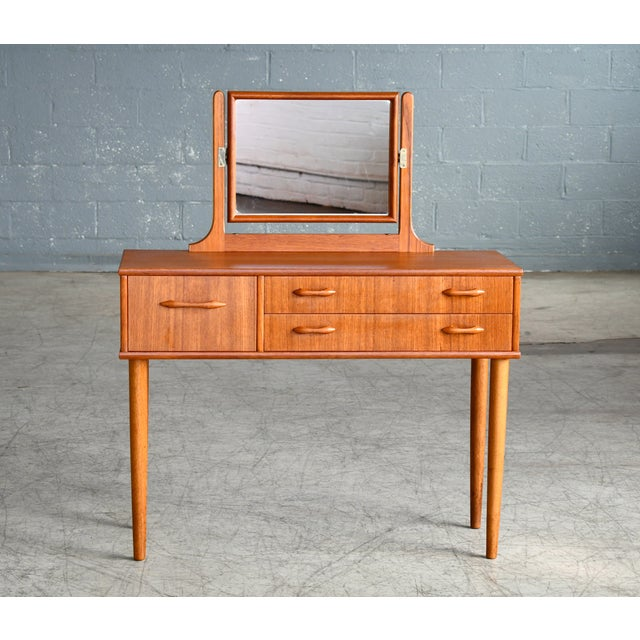 Elegant Danish teak vanity from the 1960s made from solid teak and teak veneer. Small cabinet with five nice drawers for...