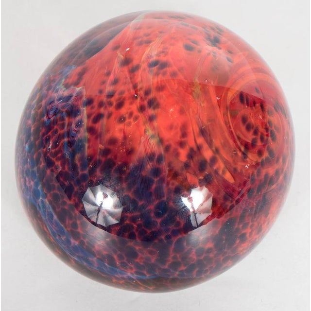 This gorgeous Mid-Century Modernist paperweight was blown by hand in Murano, Italy. It features constellations of cobalt...