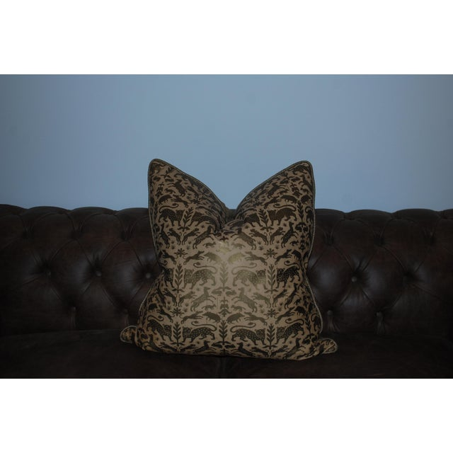 This is a pair of greyana hand-stamped leather pillows. The pieces feature an animal motif pattern.