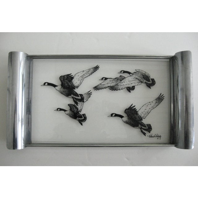 A rare glass and chrome plated aluminum 1940s tray by bird artist, Richard E. Bishop (1887 -1975). The tray features...