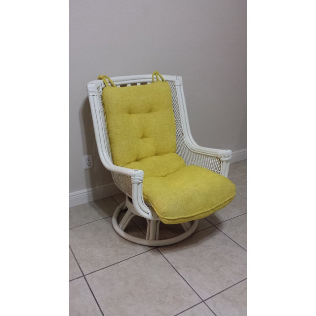 This listing is for a Vintage Swivel Egg Chair with Rattan This item has some aging imperfections/spots/scratches/touch...