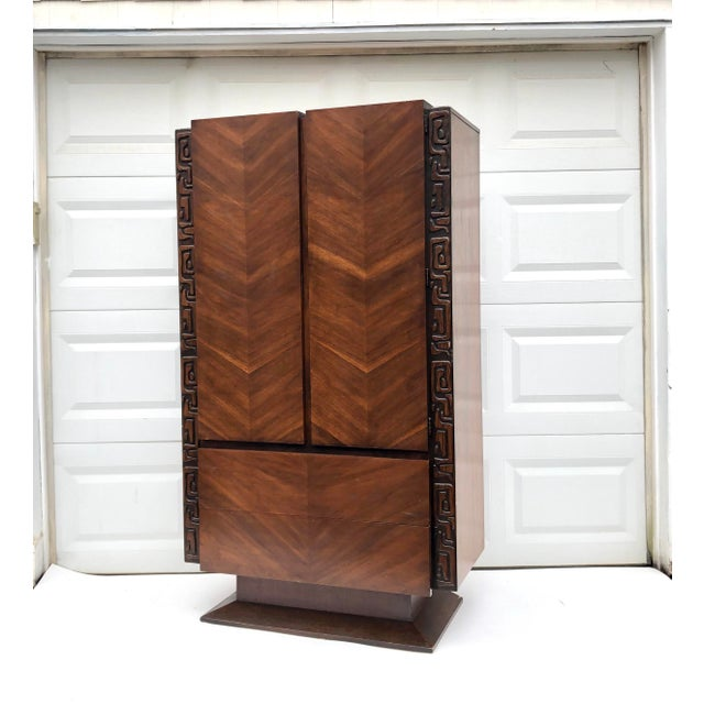This beautiful mid-century Armoire bedroom dresser features unique Witco-style tiki design. Quality vintage construction...