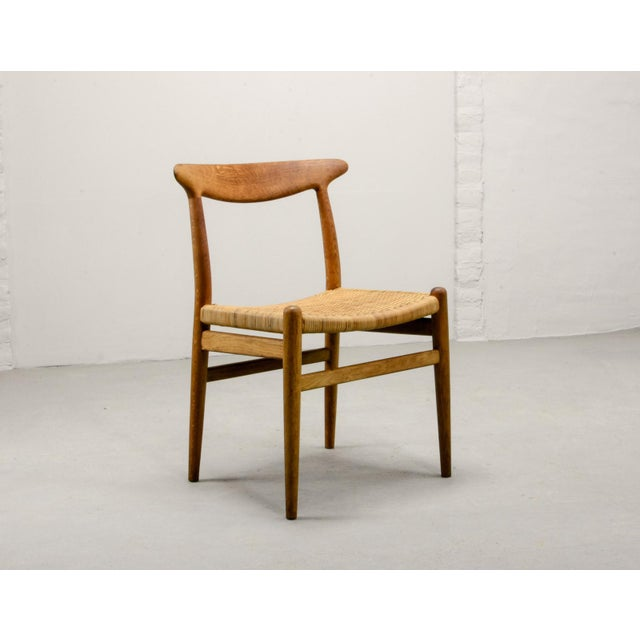 Scandinavian Side Chair W2 by Hans J. Wegner for C.M. Madsens. Denmark, 1953. Solid oak frame, woven cane seating. Very...