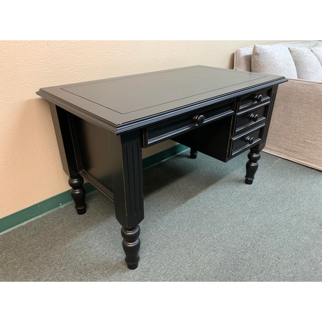 Design Plus Gallery presents a Desk by Ballard Designs. Featuring fluted and carved details, the black finished wood and...