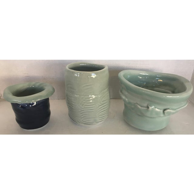 Beautiful set of three studio pottery vases. Two are signed on the bottom. Lovely seafoam color with a high gloss...