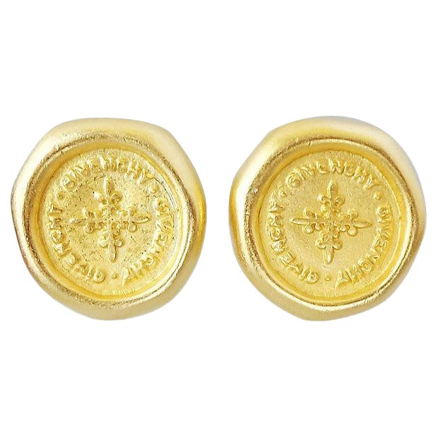 """1980s Givenchy Stamped """"Coin"""" Logo Earrings For Sale"""