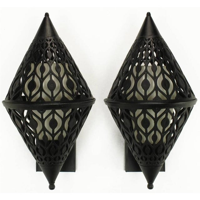 Restored pair of Gothic inspired black enameled and pierced aluminum sconces. Diamond shaped with rectangular back plate....