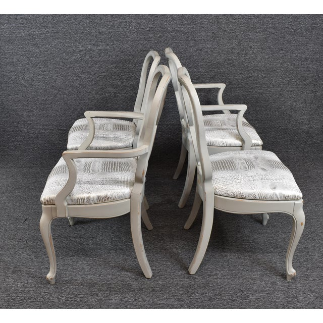 Two armchairs with two side chairs. Chairs have been restored light gray color and reupholstered in a silver canvas...