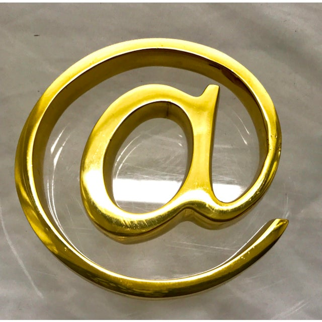 """Lacquered Brass """"At Sign"""" paperweight. In new condition. Comes with box. This piece was done by West Elm years ago,..."""