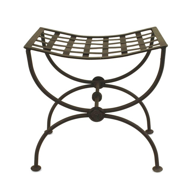 "Pair of Italian Renaissance style (1940s) black painted wrought iron benches with cross form ""X"" legs with a stretcher..."