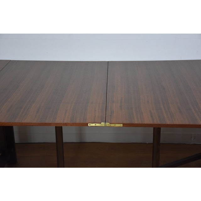 "A mid century modern walnut dining table in the style of Bruno Mathsson's ""Maria"" table. This table folds down to 7.5""..."