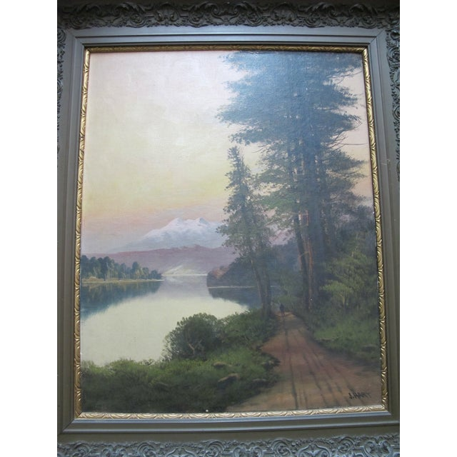 John J. Englehart (1867 - 1915) oil painting on canvas showing a sunset on Lake Tahoe, California. Signed at lower right....