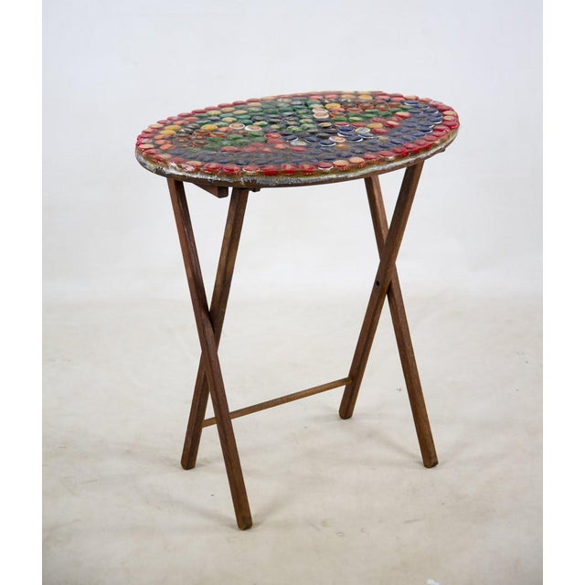 This Folk Art bottle cap side table would make a perfect addition to you man cave near the wet bar. A fun and funky...