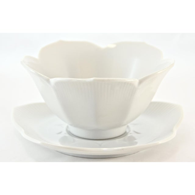 """Bright white vintage chinoiserie lotus flower bowls with petal-like saucers. Bowls, 4.75"""" W x 2.25"""" H; saucers, 5.5"""" W x..."""