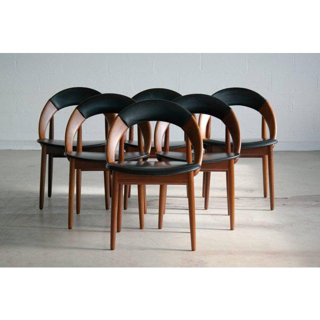 This is a very hard to find set of six iconic dining chairs designed by Arne Hovmand-Olsen. This highly coveted design is...