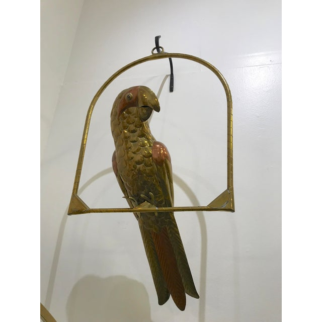 Unique brass and copper parrot on hanging perch sculpture by Sergio Bustamante. In original unpolished condition. Perch:...