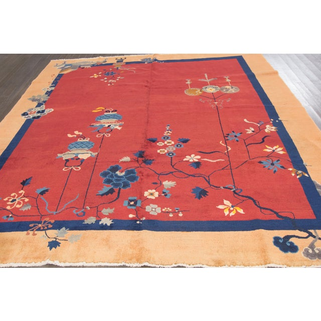 Vintage hand-knotted Chinese Art Deco rug with a floral design on a coral red field. This rug has a great color scheme and...