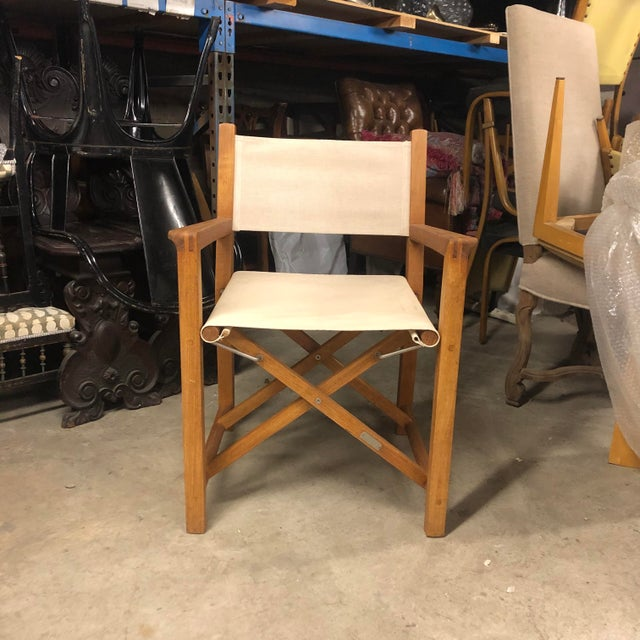 An outdoor teak foldable chair in a modern style and x shaped design. Great to pull out when extras seating is needed and...