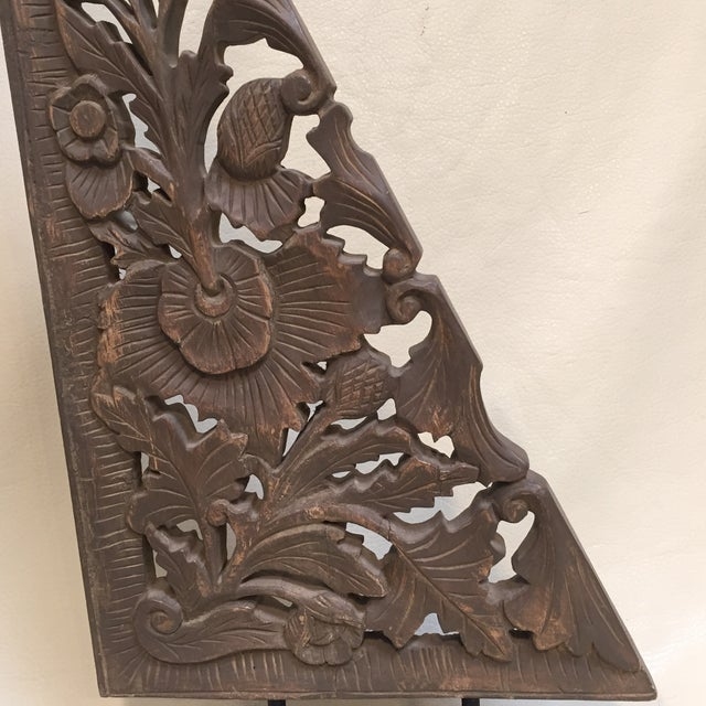 This lovely display piece comes from China. It is a handcarved wood decor item. I love the color of the distressed wood...