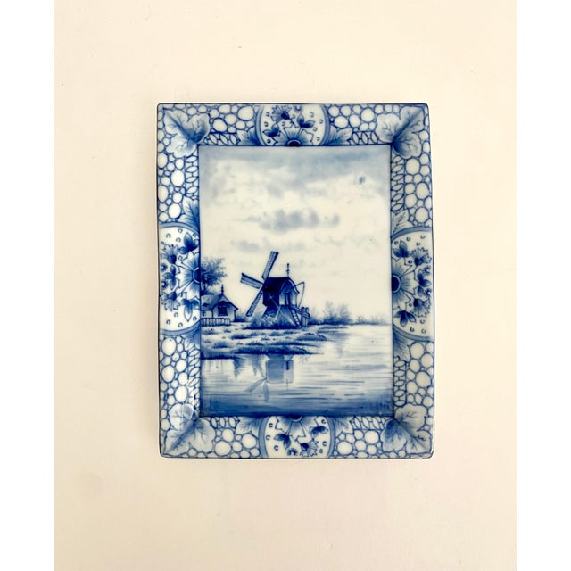 Antique hand-painted blue and white Delft plate with marking for 1920s Germany. Suitable for holding small objects or...