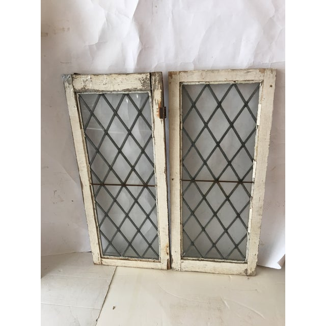 A beautiful pair of antique Leaded stained glass windows from Upstate New York. There is one piece of metal hardware left...
