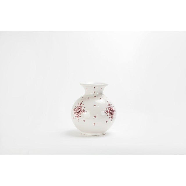Featuring wonderfully sparse yet intricate hand-painted designs, this red and white ceramic vase provides a touch of...