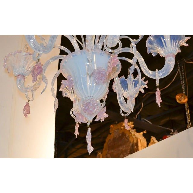 Uniquely designed antique Italian Murano blown glass opalescent chandelier in hues of pale blue and pink. The shaped stem...