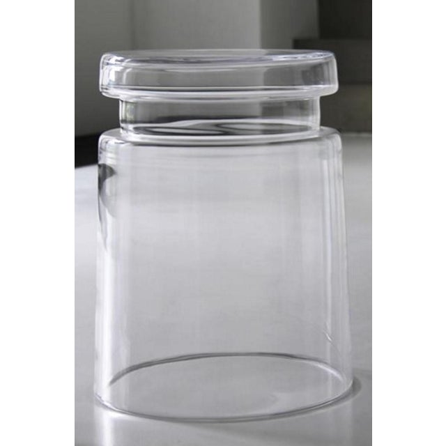 Molded clear glass stool or side table. Thick, hollow glass frame which also can be used as a large vase when placed...