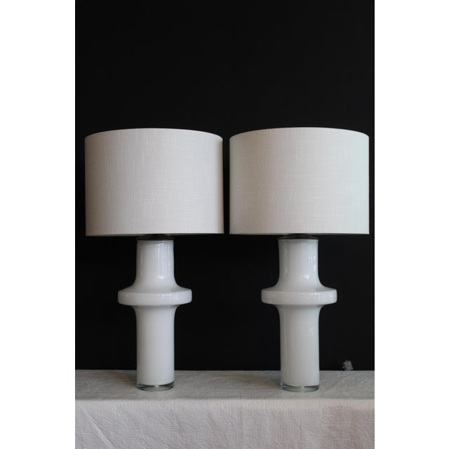 Vico Magistretti style hand blown. Murano glass table lamps. Clean and simple style. Opalescent glass captures natural and...
